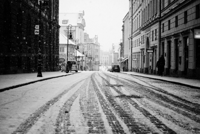 city-road-snow-street-buildings-houses-people-cars-tracks-winter